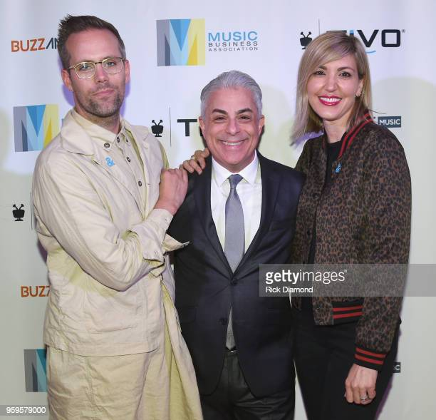 Artists Justin Tranter President of Music Business Association James Donio and manager Beka Tischker take photos before the Music Biz 2018 Awards...