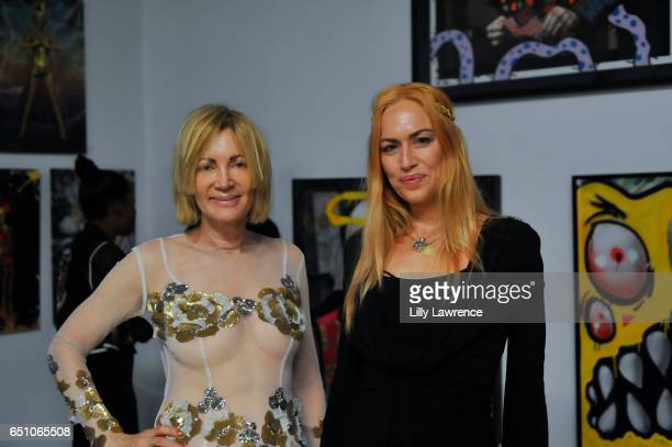 Artists Karen Bystedt and Ashley Cummings attend Karen Bystedt's 'Kings And Queens' exhibition on March 9 2017 in Los Angeles California