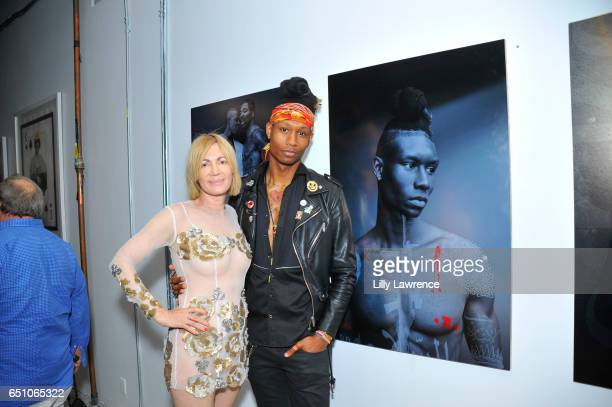 Artists Karen Bystedt and model Thrash attend Karen Bystedt's 'Kings And Queens' exhibition on March 9 2017 in Los Angeles California