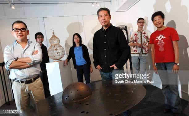 Artists Kevin Fung Likyan Kum Chikeung Fiona Wong Laiching Danny Lee Chinfai Kacey Wong Kwokchoi Rosanna Li Weihan pose for photography at a gallery...