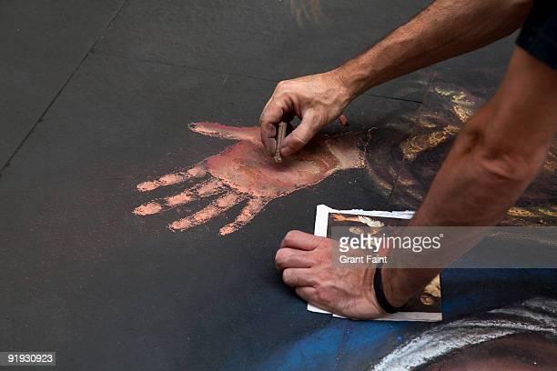 artists making chalk drawing
