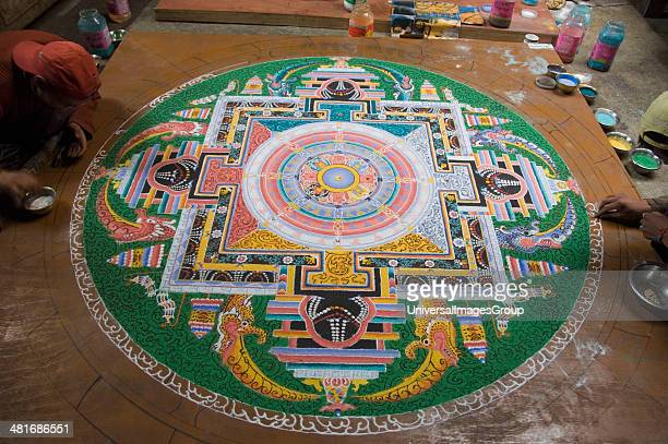 Artists making mandala on the floor of a monastery, Chemrey Monastery, Ladakh, Jammu and Kashmir, India.