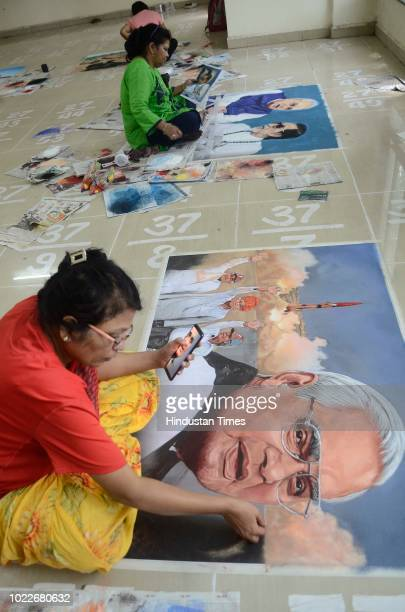 Artists making rangoli of former Prime Minister Atal Bihari Vajpayee to pay their respect at Sanas Ground on August 24 2018 in Pune India Around...