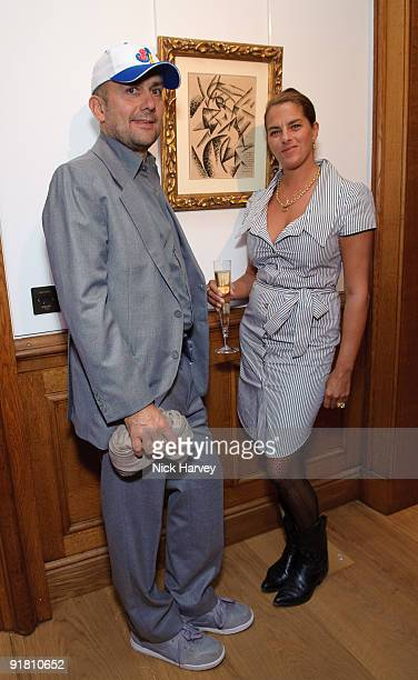 Artists Marc Quinn and Tracey Emin attend reception hosted by Graff held in aid of FACET at Christie's King Street on October 12 2009 in London...