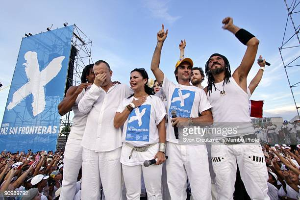 Artists Miguel Bose of Spain and Olga Tanon of Puerto Rico break out in tears as they sing together with Juanes of Colombia and XAlfonso of Cuba and...