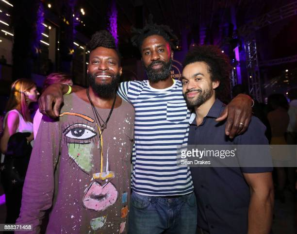 Artists Miles Regis Nyugen E Smith and Nate Lewis pose at PAMM Presents during Art Basel Miami Beach on December 07 2017 in Miami United States