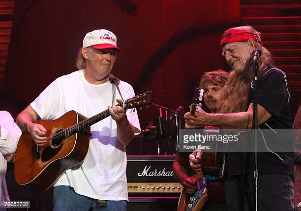 Artists Neil Young and Willie Nelson performs during Farm Aid 2007 at Randall's Island New York City New York September 9 2007