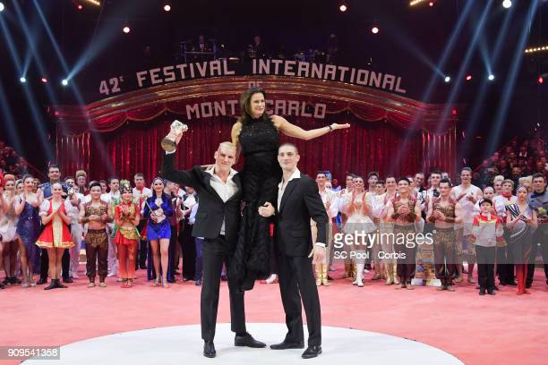 "Artists of Duo Ballance pose with Princess Stephanie of Monaco after receiving a ""Silver Clown"" during the Award Gala of the 42nd Monte-Carlo..."