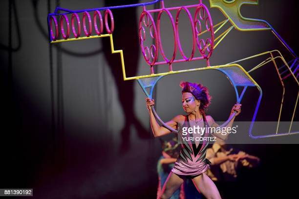 Artists of the Canadian entertainment company 'Cirque du Soleil' perform as part of the 'Soda Stereo Sep7imo Dia' programme during the premier in...