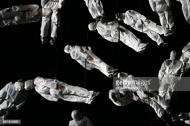 """Artists of the Catalan theatre company """"La Fura dels Baus"""" perform the """"Red Humana"""" play during the Noche Blanca festival in Burgos, northern Spain,..."""