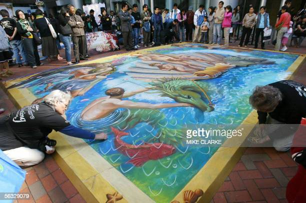 Artists paint a giant chalk drawing originally by Botticelli 'Birth of Venus' on a canvas on a private street in Hong Kong 04 December 2005 The part...