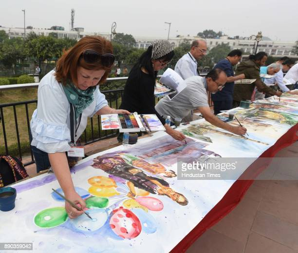 Artists painting Delhi tourist spots during 75 meter long live World Record Live Watercolor Painting at Central Park Connaught Place on December 11...