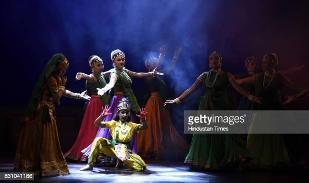 Artists perform a dance drama depicting life of Lord Krishna from his birth to his emancipation organised by Shriram Bhartiya Kala Kendra at Kamani...
