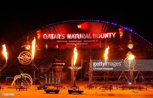 Artists perform as the LED screen celebrates Qatar's Natural Bounty during the Opening Ceremony of the 15th Asian Games Doha 2006 at the Khalifa...