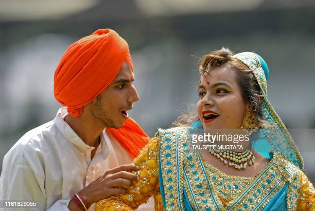 Artists perform during a cultural event during a ceremony to celebrate India's 73rd Independence Day which marks the end of British colonial rule in...