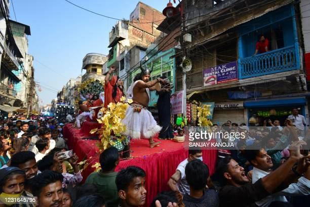 Artists perform during a religious procession to mark the Hindu festival of Maha Shivratri in Allahabad on March 11, 2021.