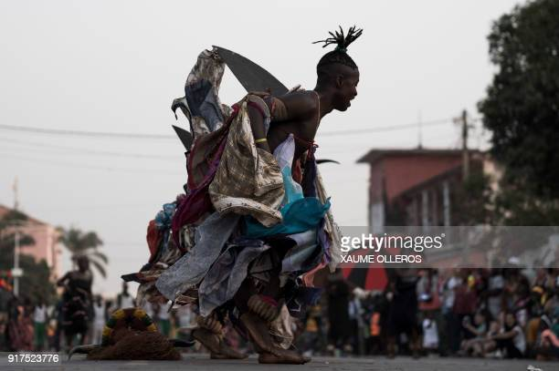 Artists perform during of the Bissau Carnival parade on February 12 2018 in Bissau The 2018 edition of the Bissau Carnival celebrating diversity and...