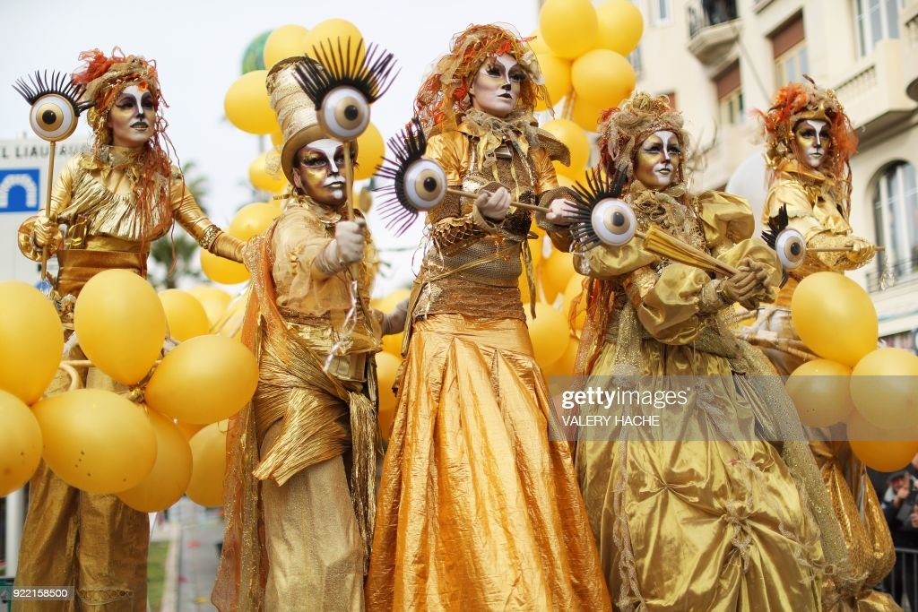 Artists perform during the 134th edition of the Nice Carnival on February 21, 2018 in Nice. The theme of this year's edition, which runs from February 17 until March 3, is the 'King of Space'. /