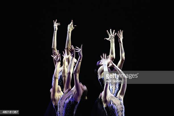 Artists perform during the 'enjoy your rhythm' gala at the GAZPROM World Cup Rhythmic Gymnastics 2014 at the Porsche Arena on March 23 2014 in...