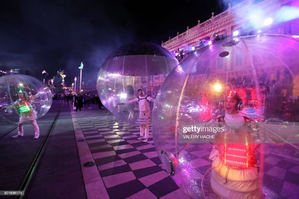 Artists perform during the Nice Carnival parade in the streets of Nice for the 134rd edition of the Nice Carnival in Nice, southeastern France on February 20, 2018. The 134th carnival runs from February 17 until March 3, 2018, and celebrates this year the 'King of Space'. /