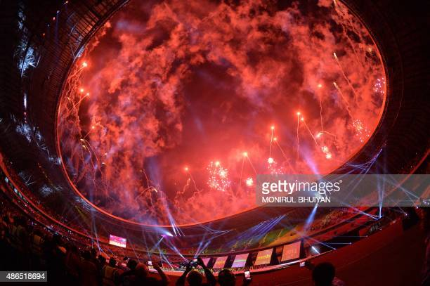 Artists perform during the opening ceremony of the 11th Africa Games in Brazzaville on September 4 2015 AFP PHOTO/MONIRUL BHUIYAN