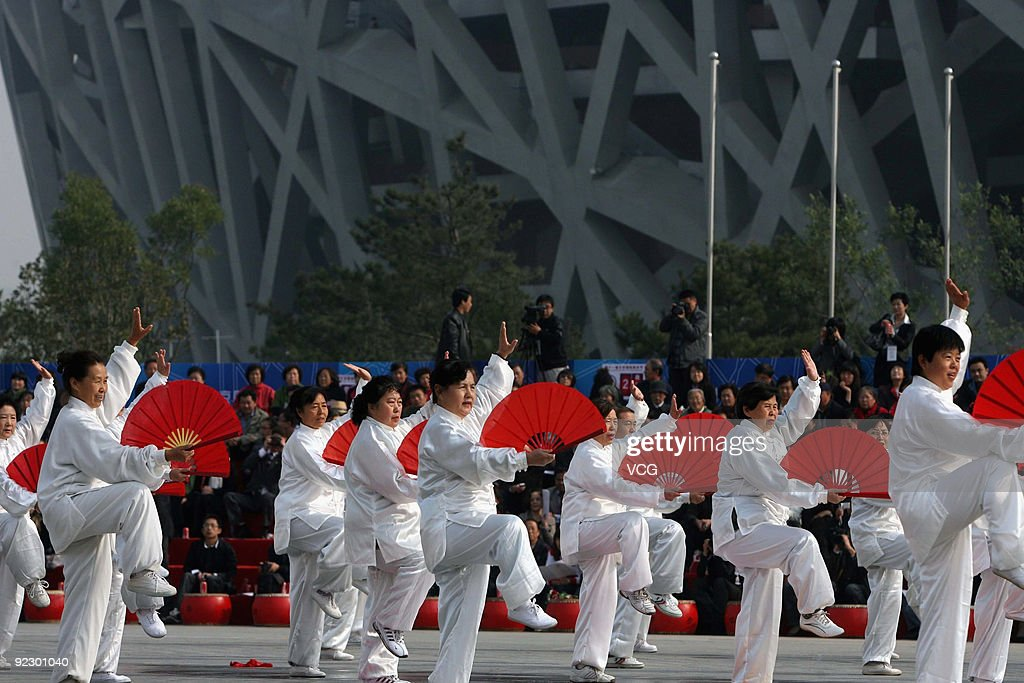 Artists perform during the opening ceremony of the 11th Beijing International Tourism Festival on October 23, 2009 at Olympic Park in Beijing of China. Nearly 3,000 artists from more than 70 countries will participate in the festival, which will be held from October 23 to 25. To get the event started with a bang, international drummers along with Chinese drum artists performed together at the opening ceremony.