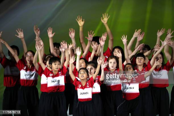 Artists perform during the Opening Ceremony passes the ball during the Rugby World Cup 2019 Group A game between Japan and Russia at the Tokyo...