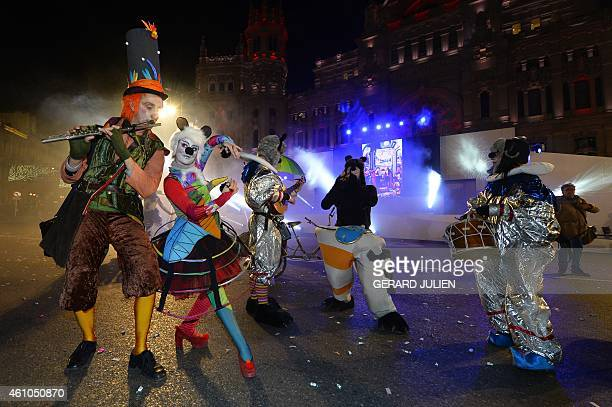 Artists perform during the Three Kings parade in Madrid on January 5 2015 Every year on January 5 children and parents can see horses oxen or other...
