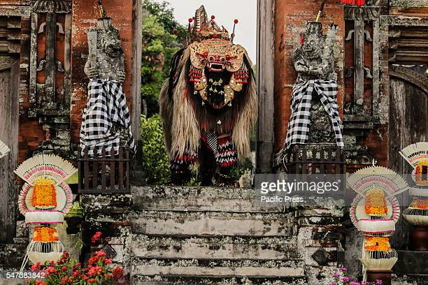 TEMPLE BADUNG BALI INDONESIA Artists perform in Balinese Barong masks during the Festival of Barong at Taman Ayun Temple Barong is a mythical...