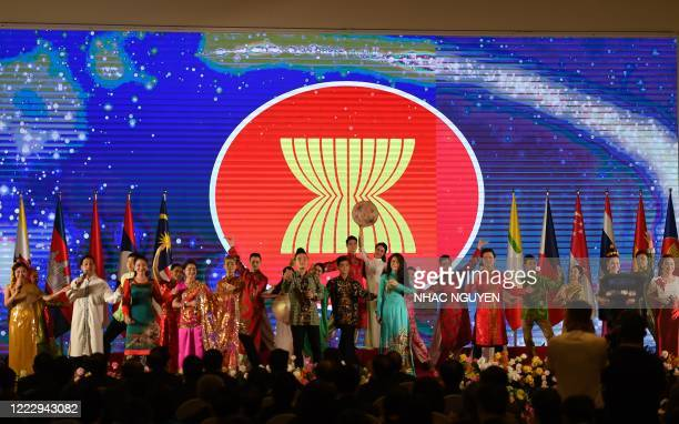 Artists perform on stage at the end of the opening ceremony of the Association of Southeast Asian Nations Summit, held online due to the COVID-19...