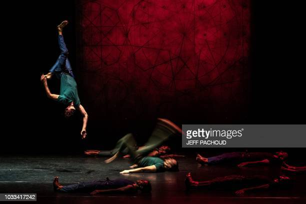 Artists perform on stage during the French choreographer Mourad Merzouki's last creation 'Vertikal' on September 15 2018 at the Maison de la Danse...