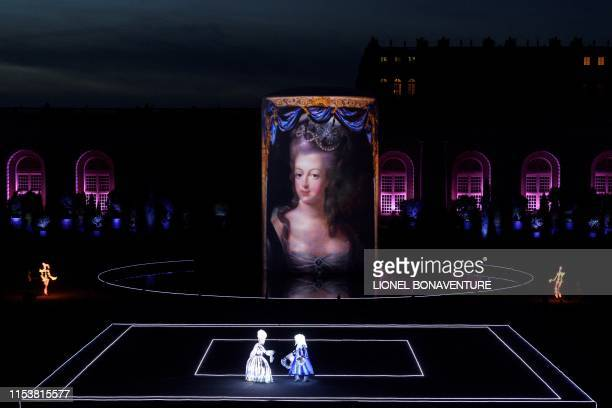 Artists perform on stage on July 4 2019 during a pyrotechnic show MarieAntoinette by Group F presenting the fate of France's tragic queen in the...