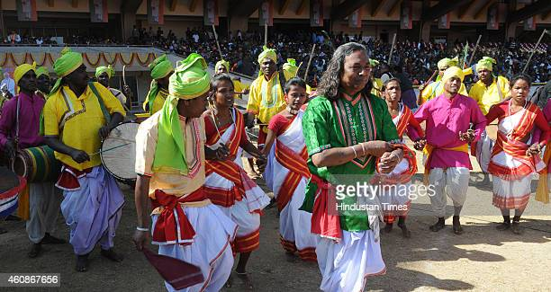 Artists performing tribal folk dance during the swearing in ceremony of Jharkhand Chief Minister Raghuvar Das at Birsa Munda Football stadium on...