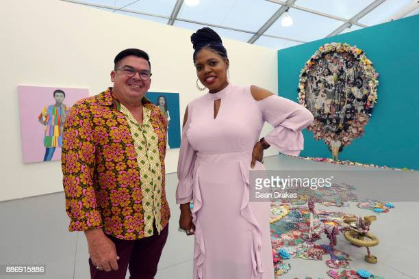 Artists Peter Sheppard of Trinidad and Ebony G Patterson of Jamaica pose by Ms Patterson's elaborate tapestries at the Monique Meloche Gallery booth...