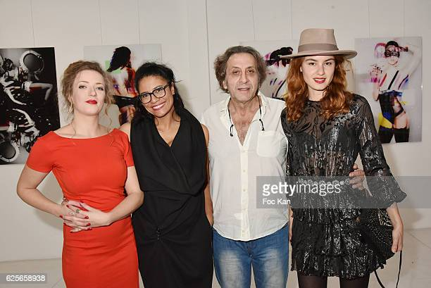 Artists Petronille Leroux Missia O Galerie 18 owner Jean Paul Lubliner and Julia Etedi attend In Beetween Collective Exhibition Preview at Galerie 18...