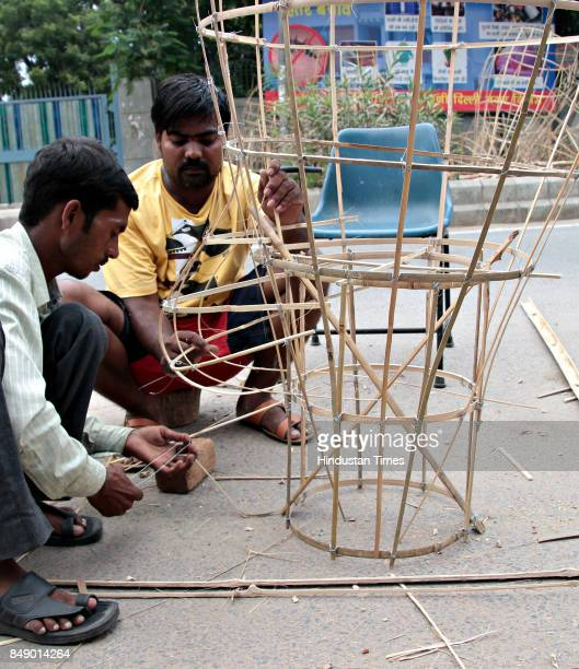 Artists preparing the effigies of Demon King Ravana his brother Khumbkaran and son Meghnad from bamboo for the upcoming Dussehra Festival on...