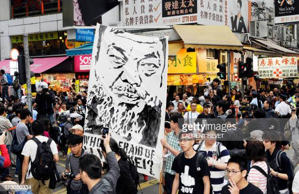 Artists protest during a march to demand the release of detained prominent Chinese artist Ai Weiwei in Hong Kong on April 23 2011 Armed with banners...