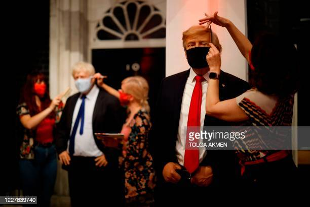 TOPSHOT Artists put the finishing touches to wax figures Britain's Prime Minister Boris Johnson and US President Donald Trump as Madame Tussauds...