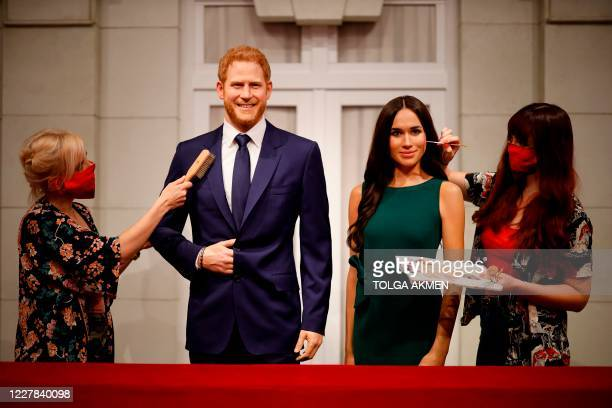 Artists put the finishing touches to wax figures of Britain's Prince Harry Duke of Sussex and Britain's Meghan Duchess of Sussex as Madame Tussauds...