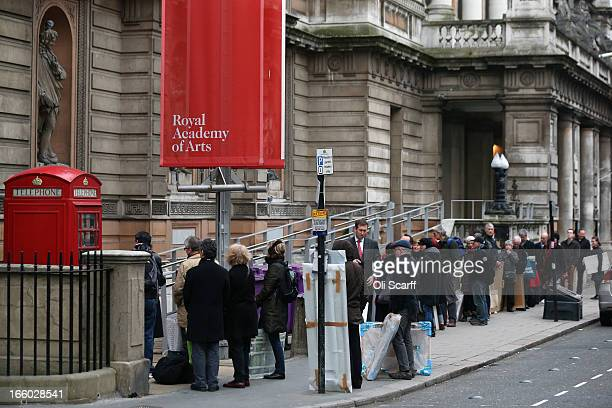 Artists queue to submit their completed artworks for the 245th Summer Exhibition at the Royal Academy of Arts on April 8 2013 in London England Last...
