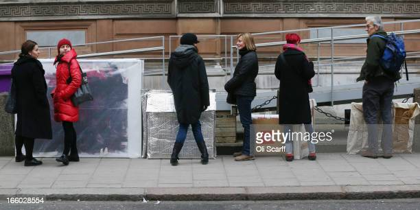 Artists queue to submit their completed artworks for the 245th Summer Exhibition at the Royal Academy of Arts on April 8, 2013 in London, England....