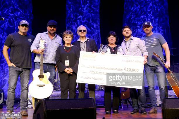 Artists Rhett Akins Dallas Davidson Dinah Gretsch Fred Gretsch Lena Thomas Logan Thomas and Ben Hayslip pose for photos onstage during the 6th Annual...