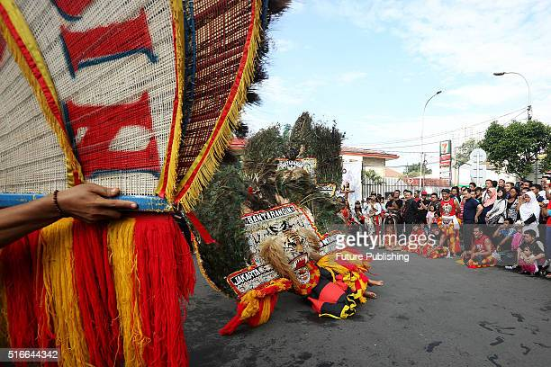Reog ponorogo stock photos and pictures getty images artists seen performing reog ponorogo dance on the street on march 20 2016 in altavistaventures Gallery