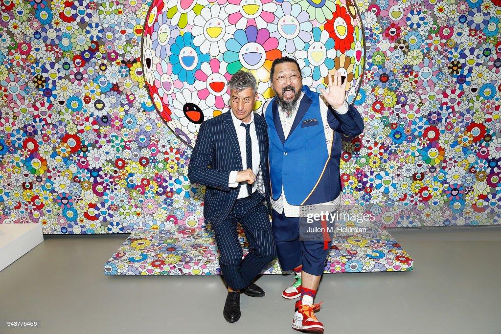 0393024279 Artists Takashi Murakami and Maurizio Cattelan attend