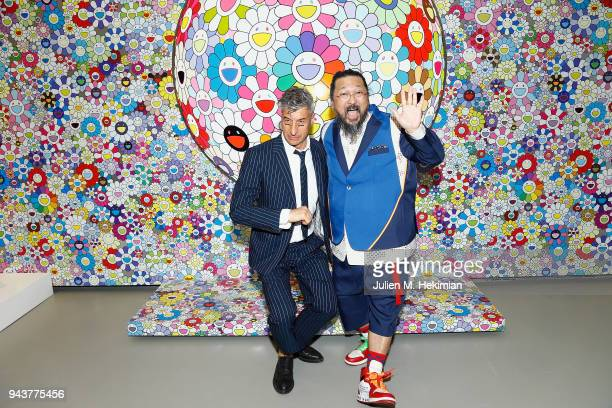 Artists Takashi Murakami and Maurizio Cattelan attend Au Diapason Du Monde Exhibition at Fondation Louis Vuitton on April 9 2018 in Paris France