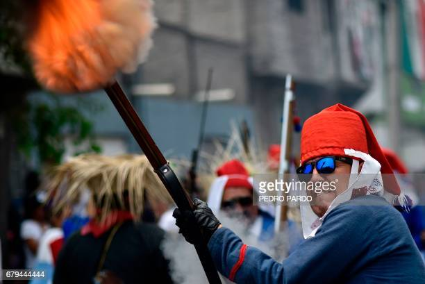 Artists take part in the reenactment of the Battle of Puebla Mexico's victory over France in 1862 during the anniversary celebration at the Penon de...