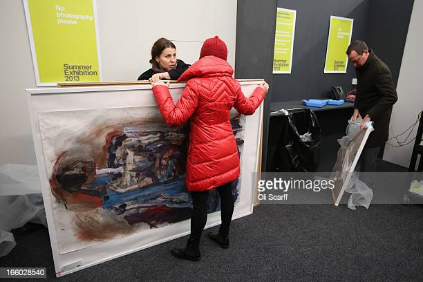 Artists unwrap their completed artworks to submit them for the 245th Summer Exhibition at the Royal Academy of Arts on April 8, 2013 in London,...