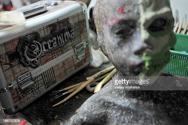 Artists use specialized makeup and other nontoxic materials as they try out thematic prosthetics on October 28 2013 in Manila Philippines The...