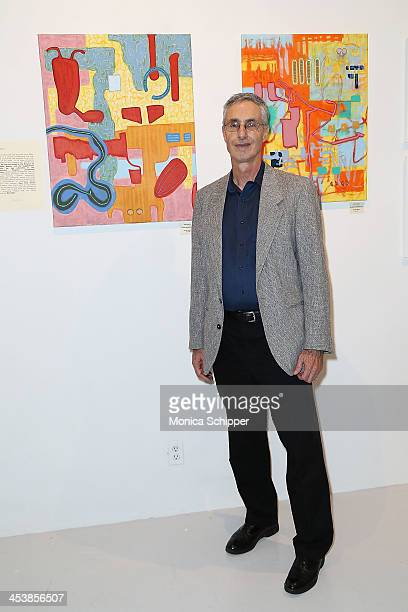 ArtistÊScott Wixon poses with his work at 'love art give a smile' Art Fashion And Design Benefit at Clen Gallery on December 5 2013 in New York City