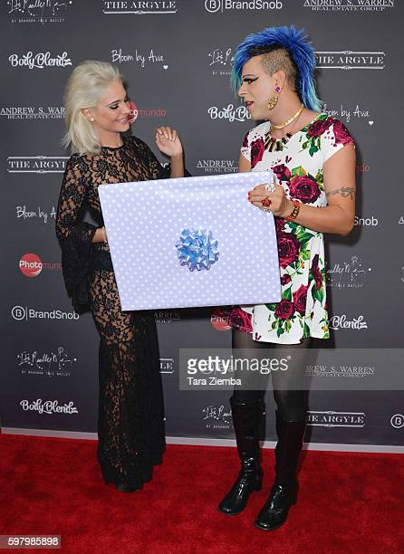 Artist/TV personality Sham Ibrahim gives Ava Capra a gift for her 21st birthday celebration at The Argyle on August 29 2016 in Hollywood California